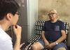 Listening can be one of the most powerful tools to build empathy in research. A researcher listening to an older man in his apartment in Hong Kong