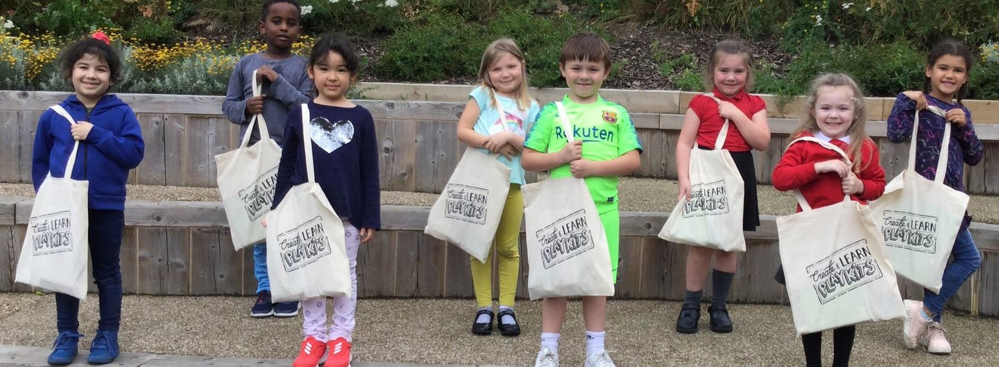 Children holding their Create & Learn PlayKit bags