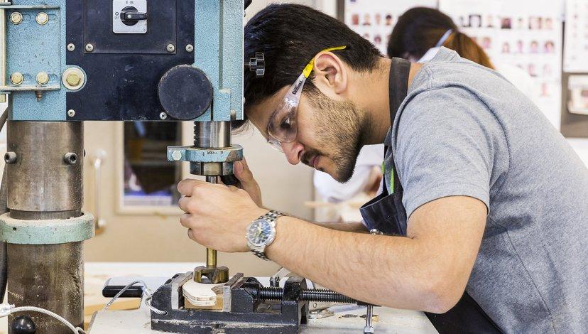 Student using a drill machine